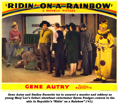 "Gene Autry and Smiley Burnette try to unravel a murder and robbery as young Mary Lee's father--showboat entertainer Byron Foulger--cowers to the side in Republic's ""Ridin' on a Rainbow"" ('41)."