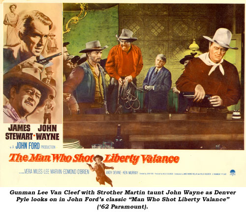 "Gunman Lee Van Cleef with Strother Martin taunt John Wayne as Denver Pyle looks on in John Ford's classic ""Man Who Shot Liberty Valance"" ('62 Paramount)."