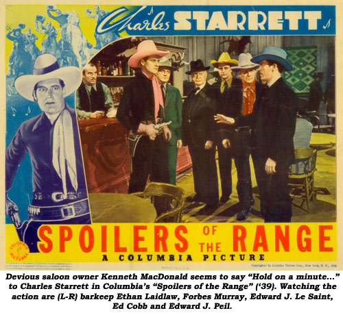 "Devious saloon owner Kenneth MacDonald seems to say ""Hold on a minute..."" to Charles Starrett in Columbia's ""Spoilers of the Range"" ('39). Watching the action are (L-R) barkeep Ethan Laidlaw, Forbes Murray, Edward J. Le Saint, Ed Cobb and Edward J. Peil."