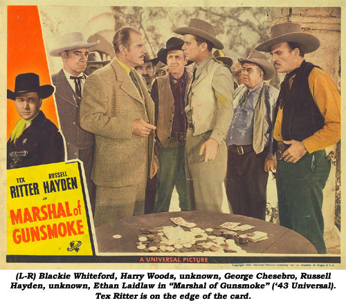 "(L-R) Blackie Whiteford, Harry Woods, unknown, George Chesebro, Russell Hayden, unknown, Ethan Laidlaw in ""Marshal of Gunsmoke"" ('43 Universal). Tex Ritter is on the edge of this lobbycard."