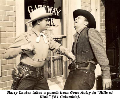 "Harry Lauter takes a punch from Gene Autry in ""Hills of Utah"" ('51 Columbia)."