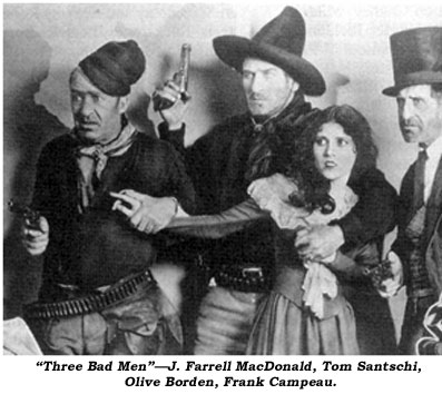 """Three Bad Men""--J. Farrell MacDonald, Tom Santschi, Olive Borden, Frank Campeau."