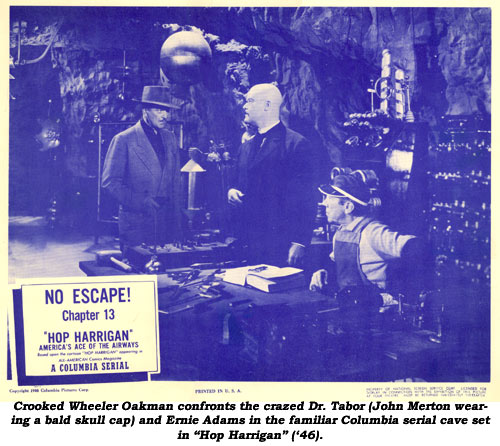 "Crooked Wheeler Oakman confronts the crazed Dr. Tobar (John Merton wearing a bald skull cap) and Ernie Adams in the familiar Columbia serial cave set in ""Hop Harrigan"" ('46)."