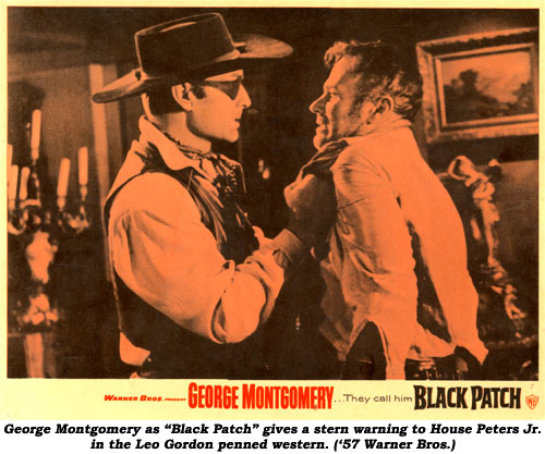"George Montgomery as ""Black Patch"" gives a stern warning to Leo Gordon ('57 Warner Bros.)."