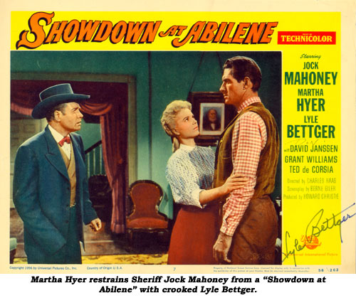 "Martha Hyer restains Jock Mahoney from a ""Showdown at Abilene"" with crooked Lyle Bettger."