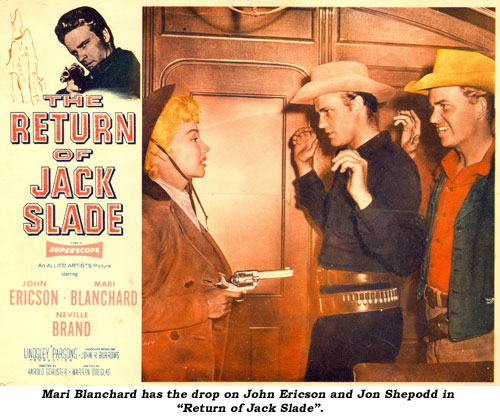 "Mari Blanchard has the drop on John Ericson in ""Return of Jack Slade""."