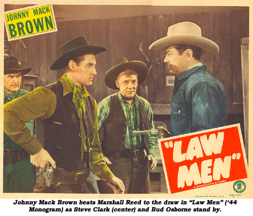 "Johnny Mack Brown beats Marshall Reed to the draw in ""Law Man"" ('44 Monogram) as Steve Clark (center) and Bud Osborne stand by."