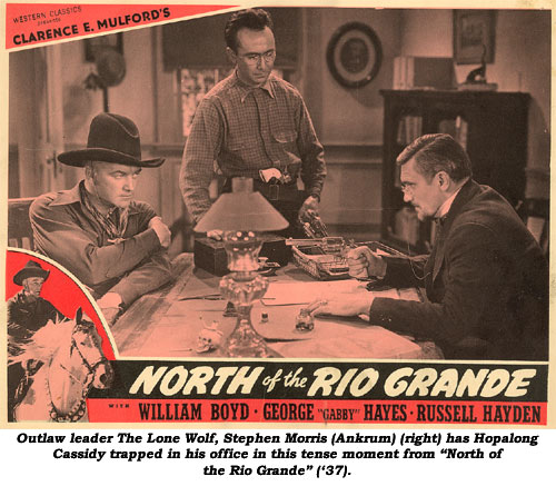 "Outlaw leader The Lone Wolf, Stephen Morris (Ankrum) (right) has Hopalong Cassidy trapped in his office in this tense moment from ""North of the Rio Grande"" ('37)."