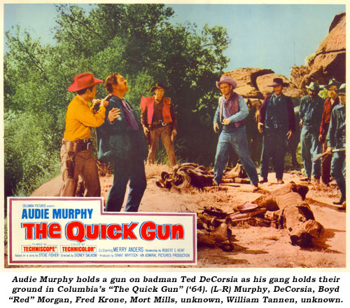 "Audie Murphy holds a gun on badman Ted DeCorsia as his gang holds their ground in Columbia's ""The Quick Gun"" ('64). (L-R) Murphy, DeCorsia, Boyd ""Red"" Morgan, Fred Krone, Mort Mills, unknown, William Tannen, unknown."