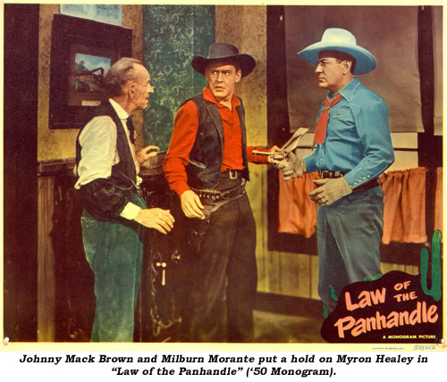 "Johnny Mack Brown and Milburn Morante put a hold on Myron Healey in ""Law of the Panhandle"" ('50 Monogram)."