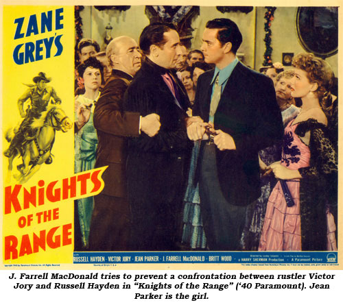"J. Farrell MacDonald tries to prevent a confrontation between rustler Victor Jory and Russell Hayden in ""Knights of the Range"" ('40 Paramount). Jean Parker is the girl."