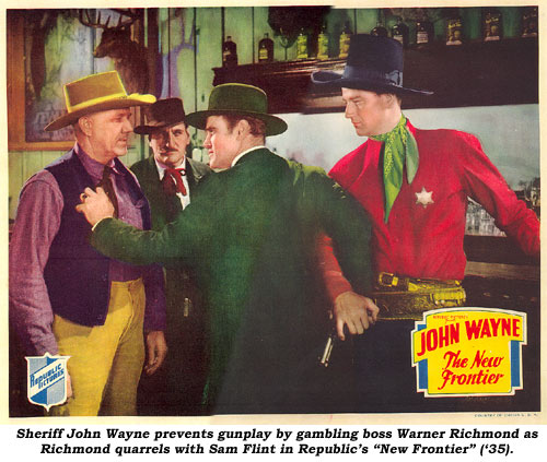 "Sheriff John Wayne prevents gunply by gambling boss Warner Richmond as Richmond quarrels with Sam Flint in Republic's ""New Frontier"" ('35)."