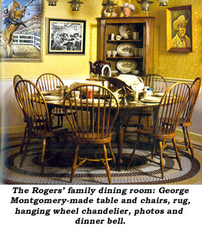 The Rogers family dinging room: George Montgomery-made table and chairs, rug, hanging wheel chandelier, photos and dinner bell.