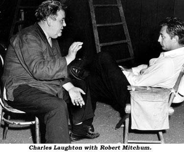 Charles Laughton with Robert Mitchum.
