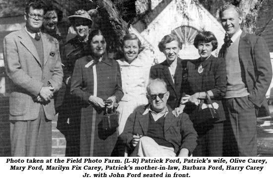 Photo taken at the Field Photo Farm. (L-R) Patrick Ford, Patrick's wife, Olive Carey, Mary Ford, Marilyn Fix Carey, Patrick's mother-in-law, Barbara Ford, Harry Carey Jr. with John Ford seated in front.