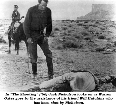 "In ""The Shooting"" ('66) Jack Nicholson looks on as Warren Oates goes to the assistance of his friend Will Hutchins who has been shot by Nicholson."