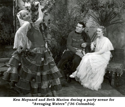 "Ken Maynard and Beth Marion during a party scene for ""Avenging Waters"" ('36 Columbia)."
