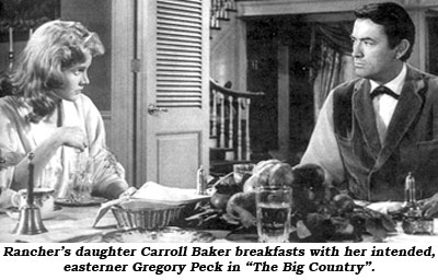 "Rancher's daughter Carroll Baker breakfasts with her intended, easterner Gregory Peck in ""The Big Country""."