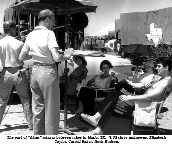 "The cast of ""Giant"" relaxes between takes in Marfa, TX. (L-R) three unknowns, Elizabeth Taylor, Carroll Baker, Rock Hudson."