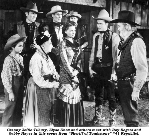 "Granny Zeffie Tilbury, Elyse Knox and others meet with Roy Rogers and Gabby Hayes in the scene from ""Sheriff of Tombstone"" ('41 Republic)."