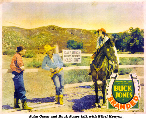 John Oscar and Buck Jones talk with Ethel Kenyon.