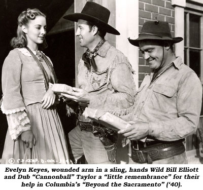 "Evelyn Keyes, wounded arm in a sling, hands Wild Bill Elliott and Dub ""Cannonball"" Taylor a ""little remembrance"" for their help in Columbia's ""Beyond the Sacramento"" ('40)."
