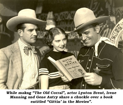"While making ""The Old Corral"", director Joe Kane, Irene Manning and Gene Autry share a chuckle over a book entitled ""Gittin' in the Movies""."
