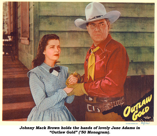"Johnny Mack Brown holds the hands of lovely Jane Adams in ""Outlaw Gold"" ('50 Monogram)."