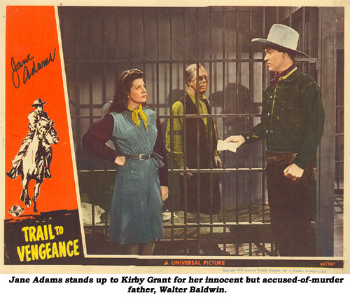"Jane Adams stands up to Kirby Grant for her innocent but accused-of-murder father, Walter Baldwin, on this lobbycard from ""Trail to Vengeance""."
