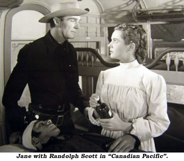 "Jane with Randolph Scott in ""Canadian Pacific""."