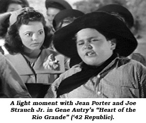 "A light moment with Jean Porter and Joe Strauch Jr. in Gene Autry's ""Heart of the Rio Grande"" ('42 Republic)."