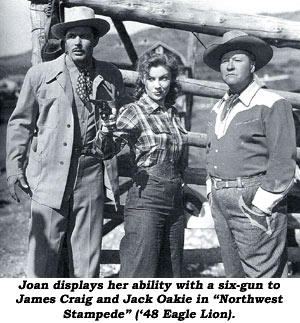 "Joan displays her ability with a six-gun to James Craig and Jack Oakie in ""Northwest Stampede"" ('48 Eagle Lion)."