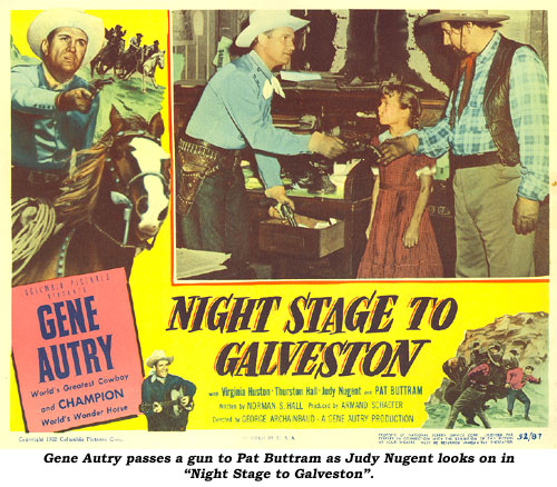 "Gene Autry passes a gun to Pat Buttram as Judy Nugent looks on on this ""Night Stage to Galveston"" lobby card."