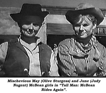 "Mischevious May (Olive Sturgess) and June (Judy Nugent) McBean girls in ""Tall Man: McBean Rides Again""."