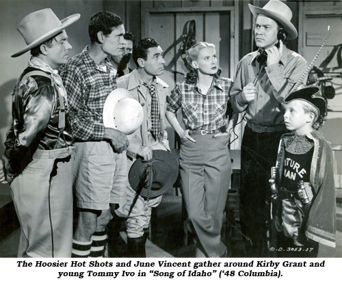 "The Hoosier Hot Shots and June Vincent gather around Kirby Grant and young Tommy Ivo in ""Song of Idaho"" ('48 Columbia)."