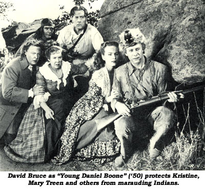 "David Bruce as ""Young Daniel Boone"" ('50) protects Kristine, Mary Treen and others from marauding Indians."