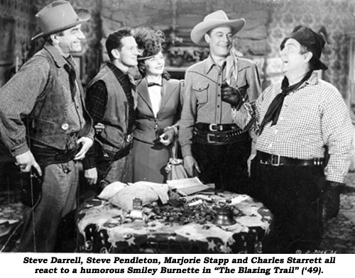 "Steve Darrell, Steve Pendleton, Marjorie Stapp and Charles Starrett all react to a humorous Smiley Burnette in ""The Blazing Trail"" ('49)."