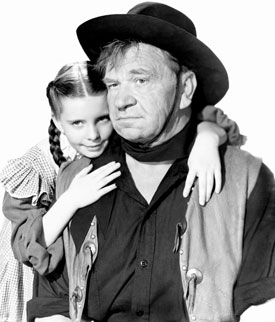"Margaret O'Brien with Wallace Beery in ""Bad Bascomb""."