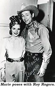 Marie poses with Roy Rogers.