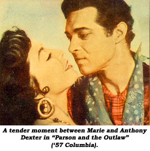 "A tender moment between Marie and Anthony Dexter in ""Parson and the Outlaw"" ('57 Columbia)."