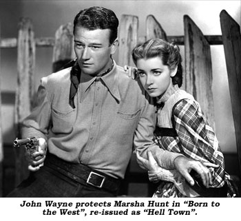 "John Wayne protects Marsha Hunt in ""Born to the Westa"", re-issued as ""Hell Town""."