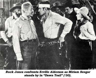 "Buck Jones confronts Erville Alderson as Miriam Seegar stands by in ""Dawn Trail"" ('30)."