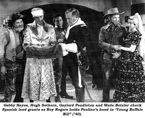 "Gabby Hayes, Hugh Sothern, Gaylord Pendleton and Wade Boteler check Spanish land grants as Roy Rogers holds Pauline's hand in ""Young Buffalo Bill"" ('40)."