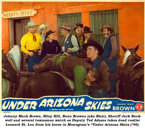 "Johnny Mack Brown, Riley Hill, Reno Browne (aka Blair), Sheriff Jack Rockwell and several townsmen watch as Deputy Ted Adams takes dead rustler Leonard St. Leo from his horse in Monogram's ""Under Arizona Skies"" ('46)."