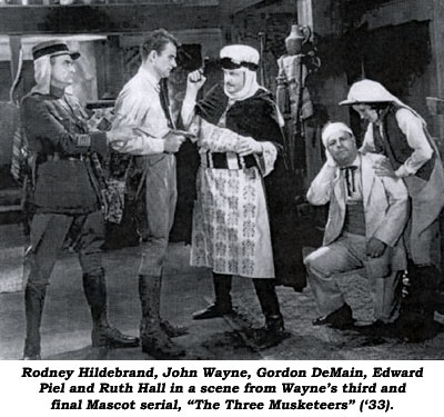 "Rodney Hildebrand, John Wayne, Gordon DeMain, Edward Piel and Ruth Hall in a scene from Wayne's third and final Mascot serial, ""The Three Musketeers"" ('33)."