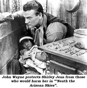 "John Wayne protects Shirley Jean from those who would harm her in ""'Neath the Arizona Skies""."