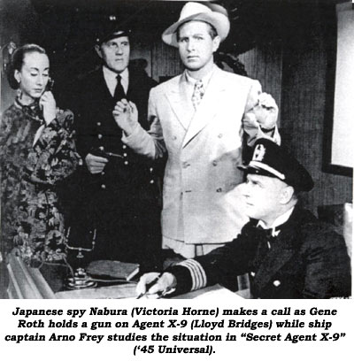 "Japanese spy Nabura (Victoria Horne) makes a call as Gene Roth holds a gun on Agent X-9 (Lloyd Bridges) while ship captain Arno Frey studies the situation in ""Secret Agent X-9"" ('45 Universal)."