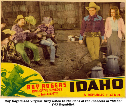"Roy Rogers and Virginia Grey listen to the Sons of the Pioneers in ""Idaho"" ('43 Republic)."