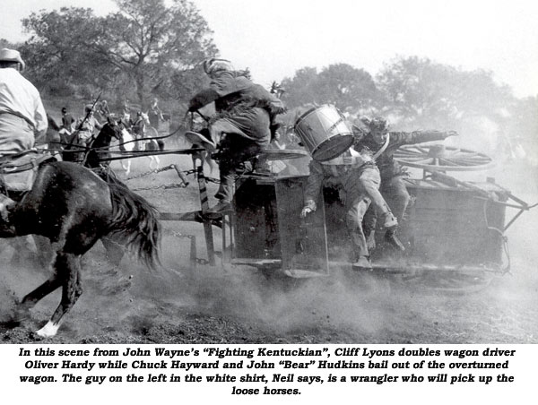 "In this scene from John Wayne's ""Fighting Kentuckian"", Cliff Lyon doubles wagon driver Oliver Hardy while Chuck Hayward and John ""Bear"" Hudkins bail out of the overturned wagon. The guy on the left in the white shirt, Neil Summers says, is a wrangler who will pick up the loose horses."