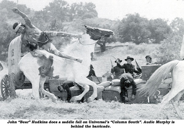 "John ""Bear"" Hudkins does a saddle fall on Universal's  ""Column South"". Audie Murphy is behind the barricade."
